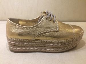 thick sole gold Prada sneaker
